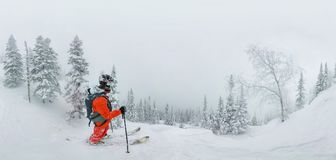 Man skier freerider standing at top of ridge, adventure winter freeride extreme sport stock images