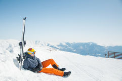 Man skier resting at mountain ski resort. Skier sportsman resting at mountain ski resort royalty free stock photography