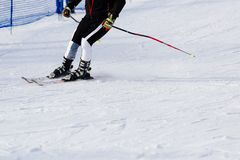 Man skier riding down the slope Stock Photo