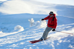 Man skier running down the hill. In european winter resort (in move Royalty Free Stock Images