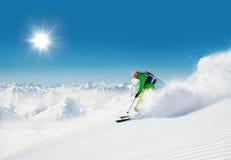 Man skier running downhill Royalty Free Stock Photo