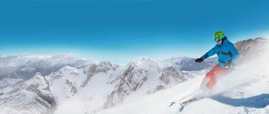 Man skier running downhill Royalty Free Stock Image