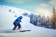 Man skier on a slope in the mountains. Man skier on a slope in the beautiful mountain view Royalty Free Stock Photo