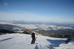 Man skier on a slope in the winter mountain royalty free stock photo