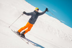 Man skier waving hands excited winner. Ypung man skier waving hands excited winner Royalty Free Stock Photography