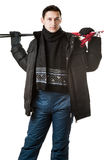 Man skier wearing black fur hood winter jacket. Young man skier wearing black fur hood winter jacket and pants holding sticks isolated on white background Stock Photography
