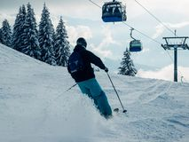 Man Skier in Zillertal Arena ski resort Zillertal Ski lifts. Man Skier in Zillertal Arena ski resort Zillertal in Tyrol. Mayrhofen in Austria in winter in Alps stock image