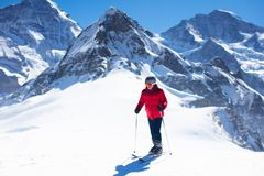 Ski and snow fun. Man skiing in mountains stock photos