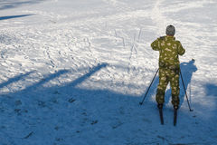 Man skiing. Bright frosty winter day. Frozen River Volga. Man skiing Royalty Free Stock Photo