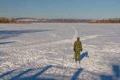 Man skiing. Bright frosty winter day. Frozen River Volga. Man skiing Royalty Free Stock Images