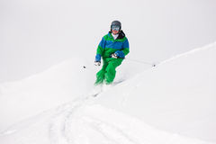 Man skiing downhill Stock Photography