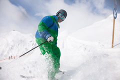 Man skiing downhill Royalty Free Stock Images