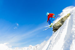 Man skiing in fresh powder snow in Italians Alps. Stock Photos