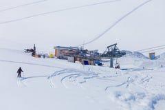 Man skiing grom hill to ski stantion in mountain of Caucasus, Gudauri. Georgia Stock Photos