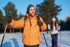Man skiing. Happy young sportsman skiing in cross-country royalty free stock photography