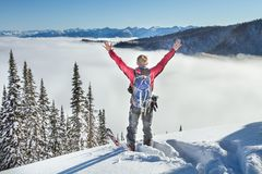A skier walks in the mountains royalty free stock photos