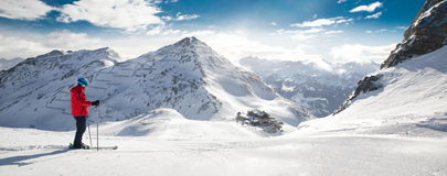 Man skiing on the prepared slope with fresh new powder snow in A. Lps Stock Image