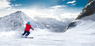 Man skiing on the prepared slope with fresh new powder snow in A stock photos