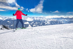 Man skiing on the prepared slope with fresh new powder snow in Alps royalty free stock image