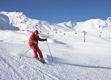 The man is skiing at a ski resort Stock Images