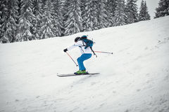 Man skiing on slope Stock Images