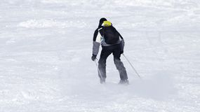 Man skiing in the snow in winter.  Royalty Free Stock Photos
