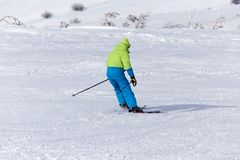 Man skiing in the snow in winter.  Stock Photography