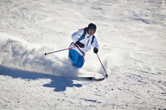 Man skiing. On sunny day royalty free stock photo