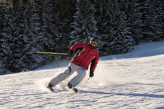 Man skiing on a sunny day Stock Photos