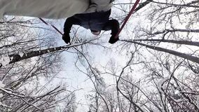 Man skiing in a winter forest. stock footage