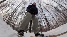 Man skiing in a winter forest. stock video footage