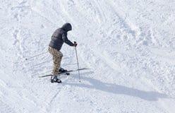 Man skiing in winter Stock Image