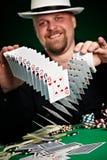 Man skilfully shuffles playing cards Royalty Free Stock Photography