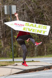 Man Skillfully Tosses Sign To Promote Atlanta Home Selling Event Stock Photography