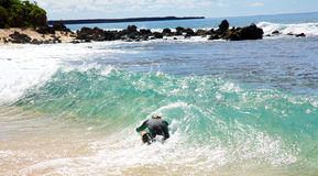 A man skimboarding at Big Beach in Maui Stock Photo