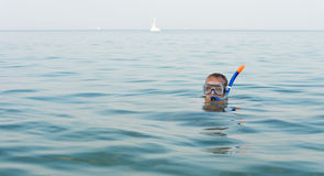 Man skindiving with goggles and snorkel Royalty Free Stock Photos