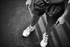 Man with skipping rope Stock Photography