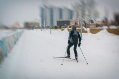 A man skis along the river Stock Photos