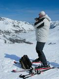 The man on skis with a camera at ski resort Royalty Free Stock Images