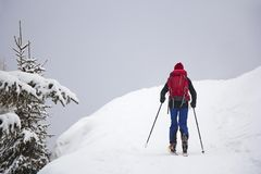 Man with skis walk by snow. On the mountain Royalty Free Stock Photo