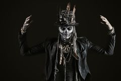 Day of the dead. A man with a skull makeup dressed in a tail-coat and a top-hat. Baron Saturday. Baron Samedi. Dia de los muertos. Day of The Dead. Halloween stock images