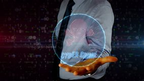Businessman with skull hologram. Man with skull symbol hologram on hand. Businessman showing futuristic concept of cyber attack, online crime, pirate, theft and stock footage