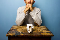 Man with skull is thinking Stock Images