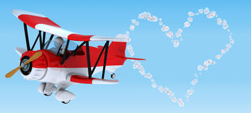 Man sky writing in a biplane Royalty Free Stock Image