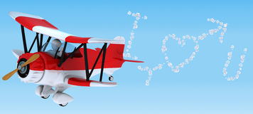 Man sky writing in a biplane Stock Photos