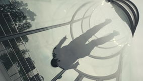 Man skydiver flies in wind tunnel. Flying in a wind tunnel. Extreme sports stock video