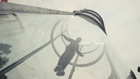 Man skydiver flies in wind tunnel. Flying in a wind tunnel. Extreme sports royalty free stock image
