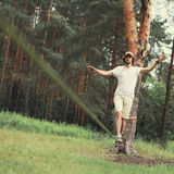Man slacklining walking and balancing on a rope, slackline in forest Stock Photography