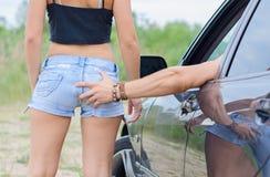 Man slaps girl's ass. Royalty Free Stock Photo