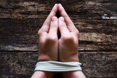 Man slave prays with his hands tied Stock Photography
